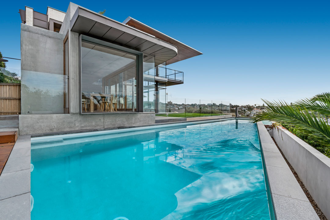 TradeMark Pools concrete pool built flush with house